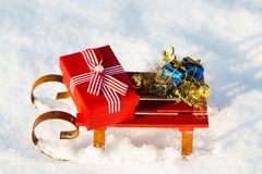 Gifts on sled in the snow Stock Photo