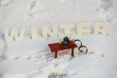 Gifts on sled in the snow Royalty Free Stock Photography