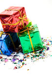 Gifts: Small Stack Of Christmas Gifts With Confetti. Series of miniature, colorful gift boxes, some on colored backgrounds, some on white Royalty Free Stock Photography