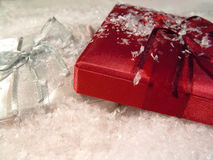 Gifts on Snow 2. Red and silver gifts in the snow Stock Image
