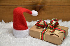 Gifts Snow Christmas wooden background Stock Images