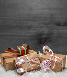 Gifts Snow Christmas wooden background Stock Image
