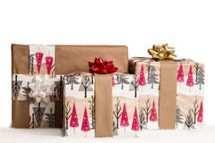 Gifts in Snow on white copyspace. Three holiday/Christmas gifts in the snow on a white background Stock Image