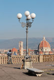 Gifts and souvenirs for sale and Florence cityscape Stock Image