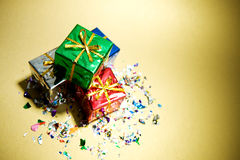 Gifts: Stack Of Christmas Gifts With Confetti. Series of miniature, colorful gift boxes, some on colored backgrounds, some on white Stock Photography