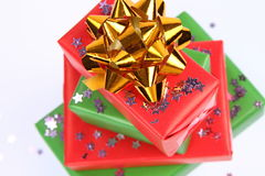 Gifts and star shaped confetti Royalty Free Stock Image