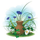 Gifts of summer. Daisy, cornflowers, strawberry and earthenware pot of milk Stock Images