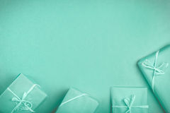 Gifts on the table. Blue packed gift on the blue table with copy space. Christmas concept Royalty Free Stock Images