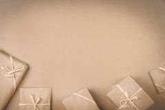 Gifts on the table. Brown packed gifts on the gray paper with copy space. Christmas concept Royalty Free Stock Image