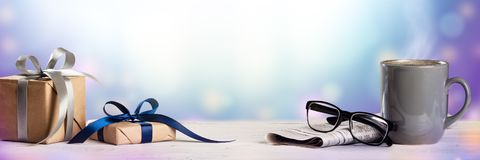 Gifts On Table With Newspapers Reading Glasses royalty free stock photography