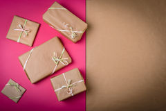 Gifts on the table. Gifts on the pink table with copy space on the right Royalty Free Stock Photography