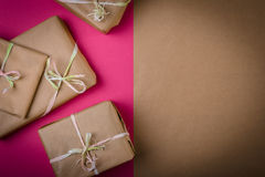 Gifts on the table. Gifts on the pink table with copy space on the right Stock Photos