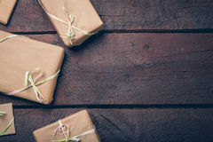 Gifts on the table. Gifts on the wooden table with copyspace Stock Photos