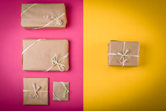 Gifts on the table. Gifts on the yellow and pink table Stock Photography