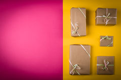 Gifts on the table. Gifts on the yellow and pink table Royalty Free Stock Photography