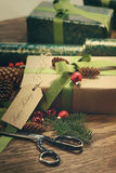 Gifts with tag for the holidays on wood table Royalty Free Stock Images