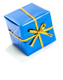 Gifts: Tiny Blue Wrapped Hanukkah Gift. Series of miniature, colorful gift boxes, some on colored backgrounds, some on white Stock Image