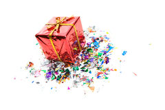 Gifts: Tiny Gift Box Surrounded By Confetti. Series of miniature, colorful gift boxes, some on colored backgrounds, some on white Royalty Free Stock Photo