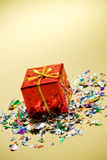 Gifts: Tiny Present With Confetti Around. Series of miniature, colorful gift boxes, some on colored backgrounds, some on white Stock Photos