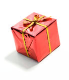 Gifts: Tiny Red Wrapped Christmas Gift. Series of miniature, colorful gift boxes, some on colored backgrounds, some on white Stock Photos