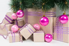 Gifts and toys for the New Year tree under the green branches fr royalty free stock photo