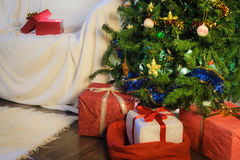 Gifts and tree in christmas night Royalty Free Stock Images