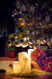 Gifts under Christmas tree in ambient living room with fireplace. N royalty free stock photo