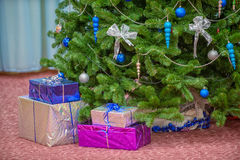 Gifts under christmas tree Royalty Free Stock Photos