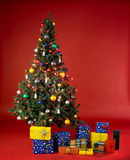 Gifts under the multi color Christmas tree Stock Photo