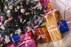Gifts under a New Year`s tree. Gifts under the New Year tree in beautiful packages Royalty Free Stock Images