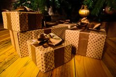 Gifts are under the tree. Boxes with Christmas gifts under the tree stock photos