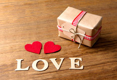 Gifts for Valentine's Day. Decorative boxes and felt hearts Royalty Free Stock Photography