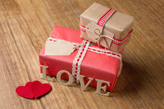 Gifts for Valentine's Day. Decorative boxes and felt hearts Stock Image