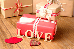Gifts for Valentine's Day. Decorative boxes and felt hearts Royalty Free Stock Photo
