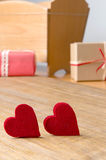 Gifts for Valentine's Day. Decorative boxes and felt hearts Stock Images