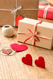 Gifts for Valentine's Day. Decorative boxes and felt hearts Royalty Free Stock Images