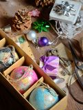Gifts and vintage christmas ornaments. On wooden table Royalty Free Stock Photo
