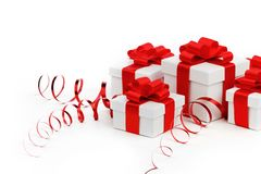 Gifts in white boxes with red ribbons royalty free stock image