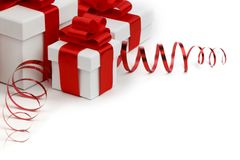 Gifts in white boxes with red ribbons Stock Photo