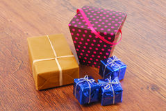 Gifts on wooden surface Royalty Free Stock Images
