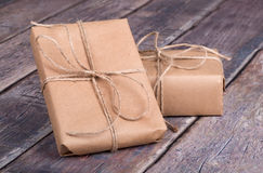 Gifts Wrapped in Brown Paper Stock Photo