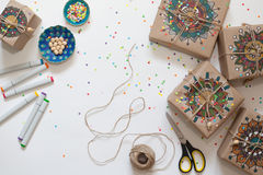 Gifts wrapped in kraft paper. On boxes painted mandala pattern. Stock Image