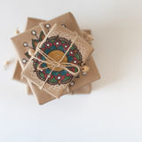 Gifts wrapped in kraft paper. The packaging ornament mandala. Royalty Free Stock Images