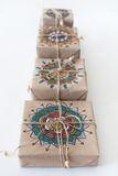 Gifts wrapped in kraft paper. The packaging ornament mandala. Royalty Free Stock Photos
