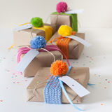 Gifts wrapped in kraft paper and tied with ribbons knitted. Stock Photography