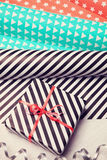 Gifts and wrapping paper on white wooden background. Stock Images