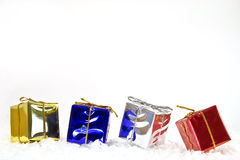 Gifts for you. Gifts on snow with a white background Royalty Free Stock Image