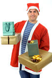 Gifts. Young man with santa hat holding some gifts, isolated Stock Photography