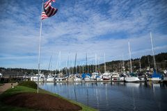 Gig Harbor Washington. On a sunny day in Washingon's Gig Harbor the boats sit quietly on the water under a blue sky. A favorite for tourists and locals alike Royalty Free Stock Photography