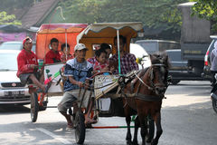 Gig. People enjoy traveling with tour gig in the city of Solo, Central Java, Indonesia royalty free stock photo